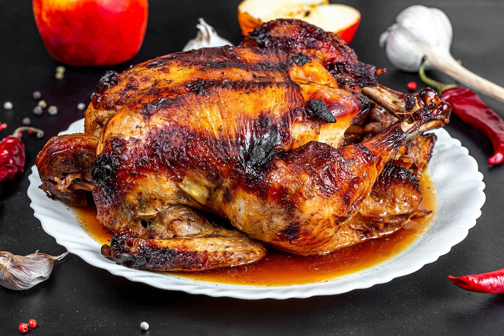 Close up of baked chicken with apples
