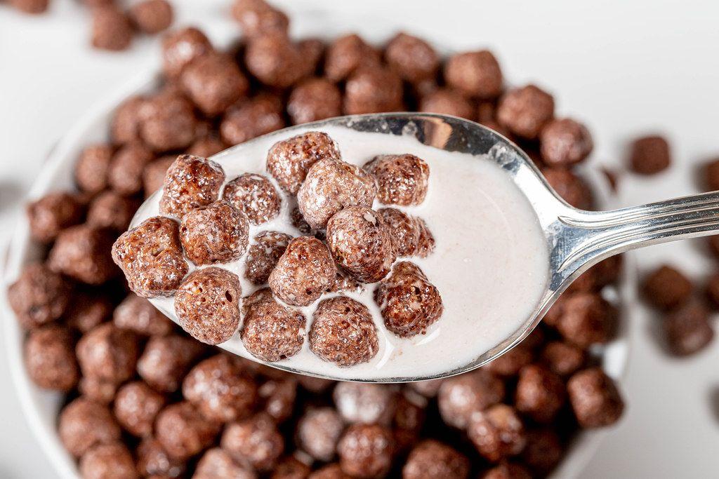 Close up of chocolate corn balls with milk (Flip 2019)