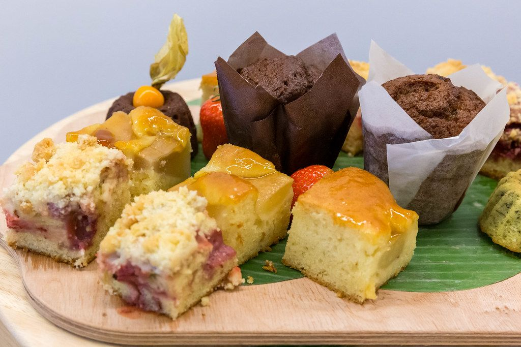 Close-up of chocolate muffins and various pieces of fruit cake on a kitchen board at the buffet table of AXA Barcamp OMWest 2019 in Cologne, Germany