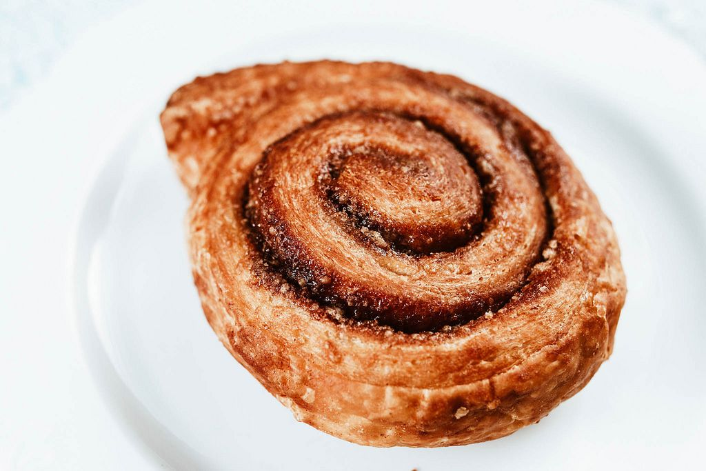 Close up of Cinnamon Roll on a white background.