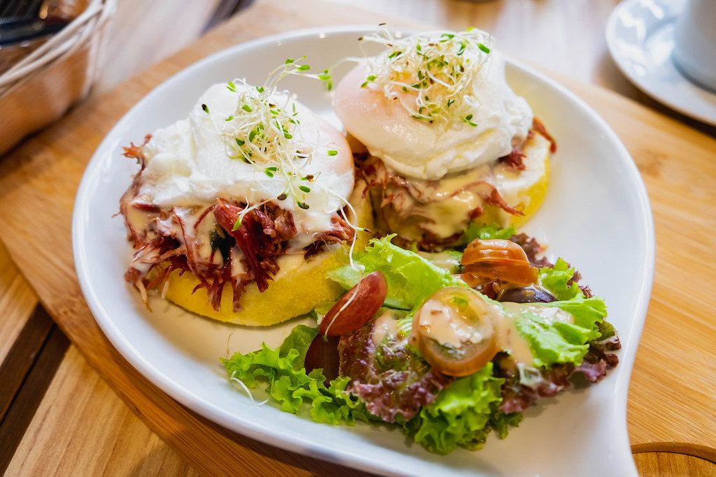 Close up of corned beef burger meal with poached egg (Flip 2019)