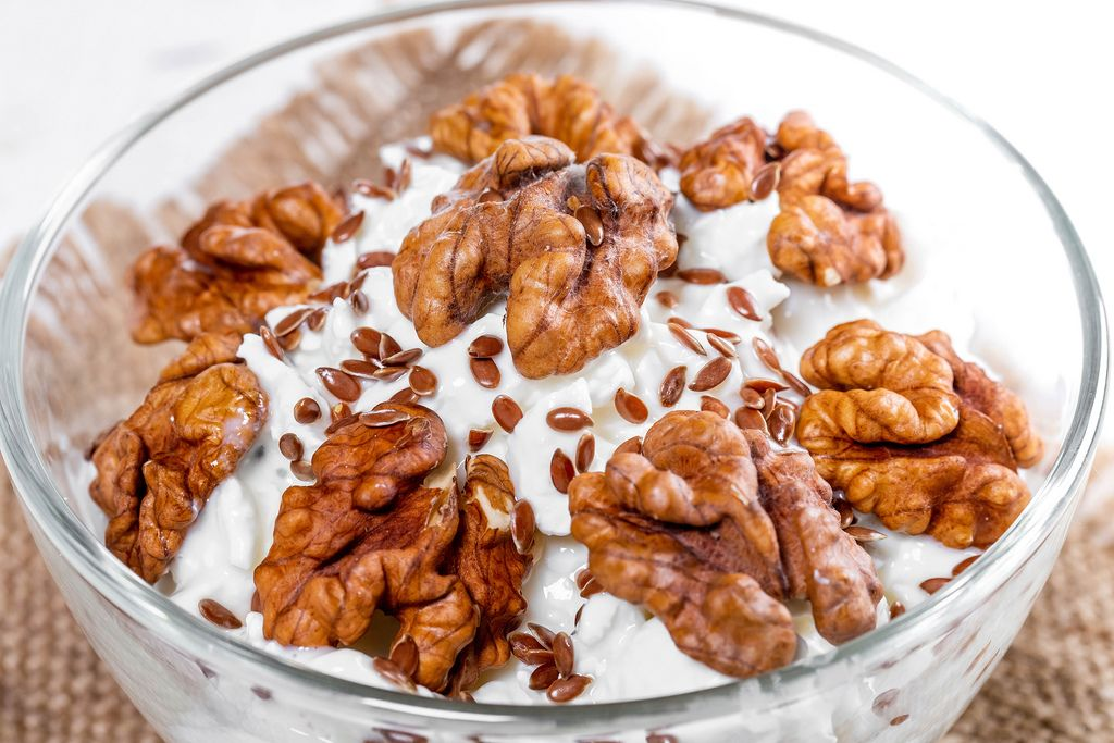 Close-up of cottage cheese dessert with walnuts and flax seeds (Flip 2019)