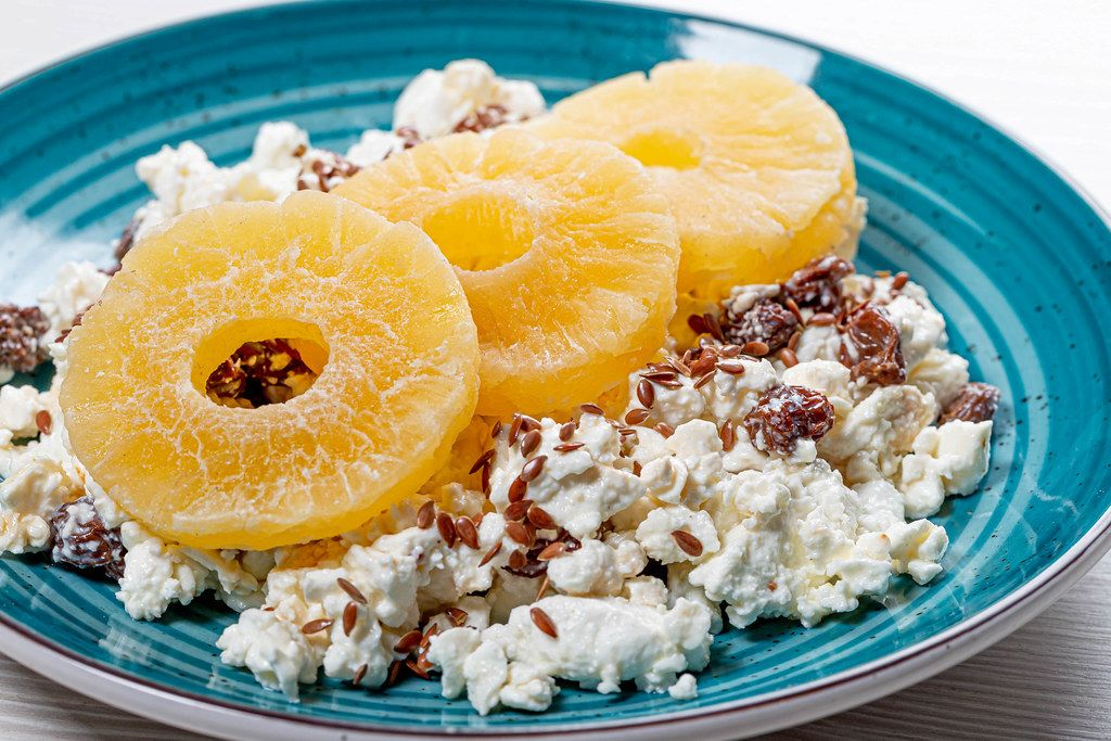Close up of cottage cheese with flax seeds and dried pineapple rings (Flip 2019)