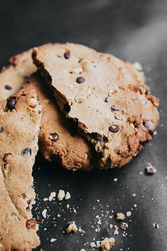 Close up of crushed chocolate cookie on black background.