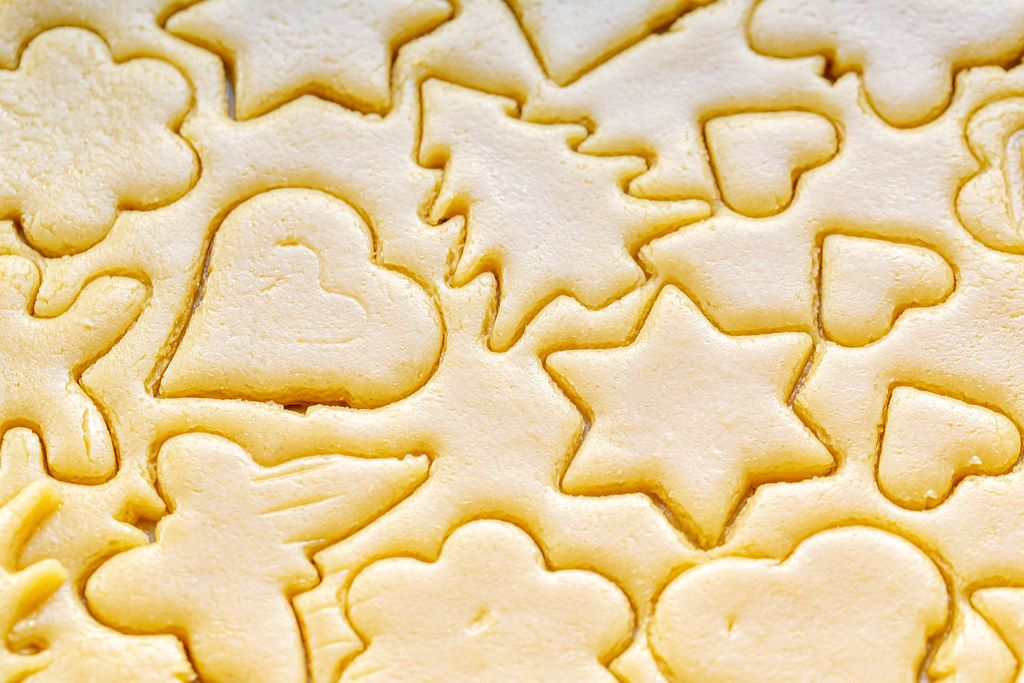 Close-up of cut different shapes of cookies in raw dough
