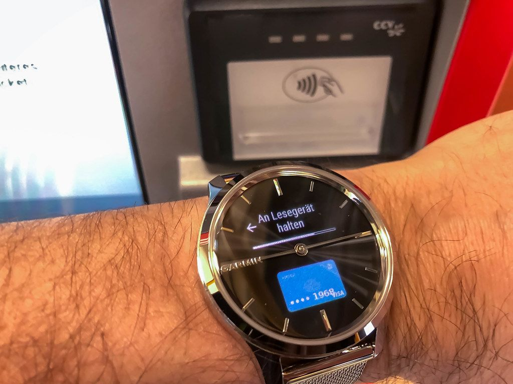 Close-up of Garmin smartwatch used for contactless payment via the Garmin Pay system