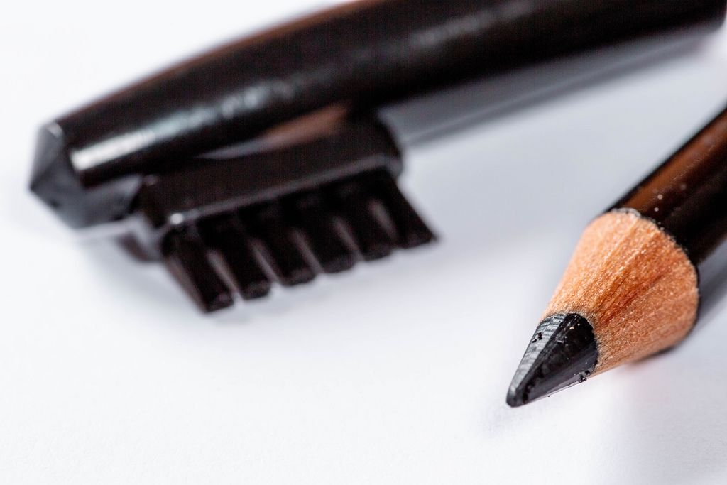 Close up of Make up pencil over white
