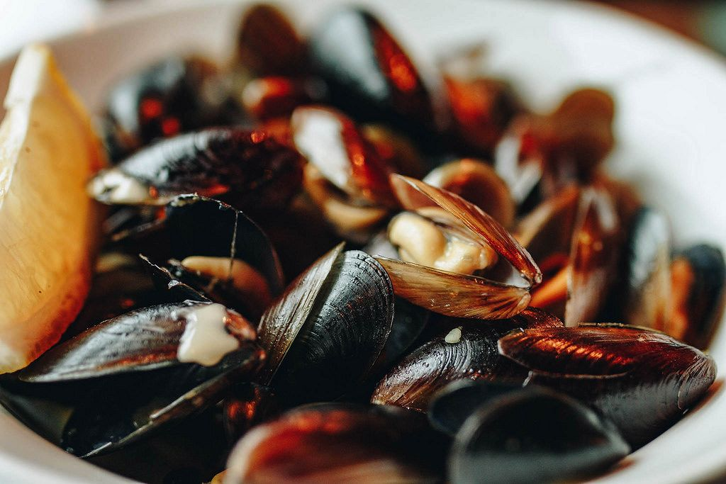 Close up of mussels in a plate. Restaurant background.