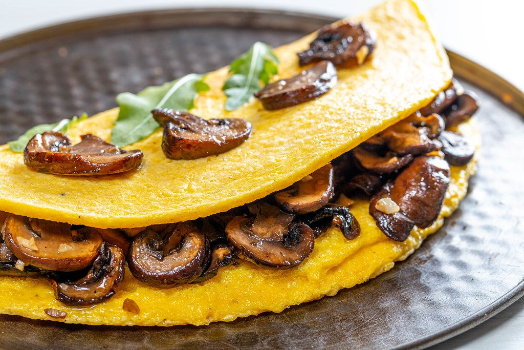 Close-up of omelet with mushrooms (Flip 2019)