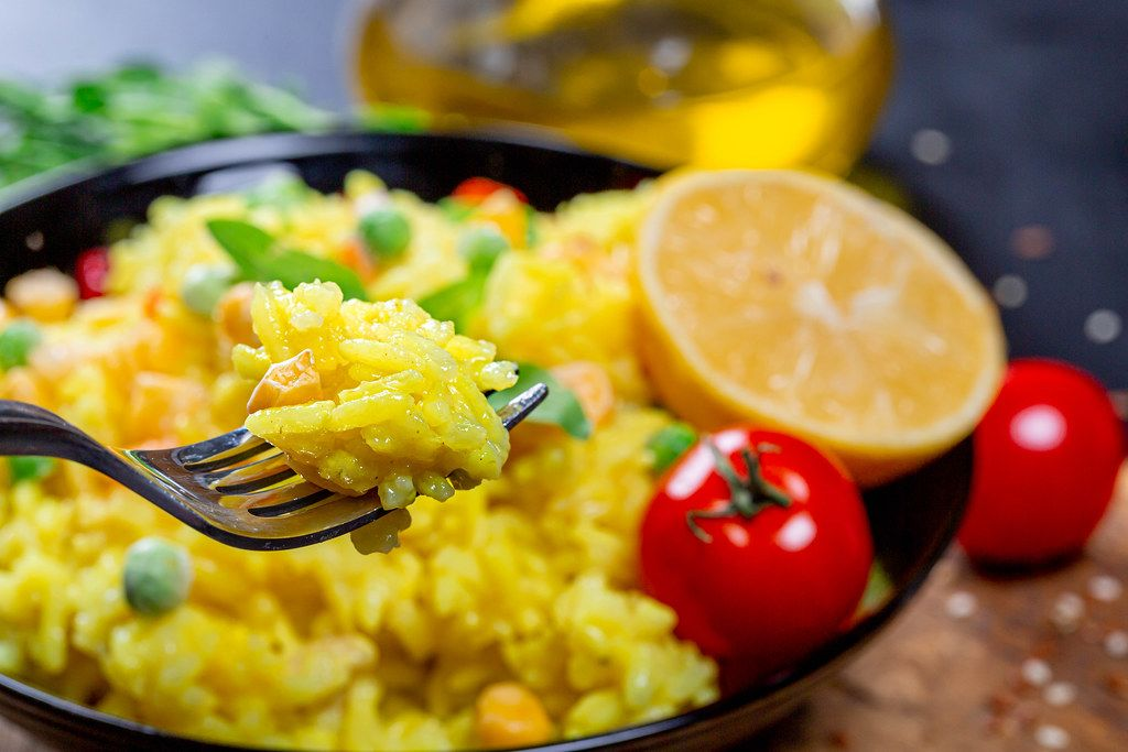 Close up of rice porridge on a fork