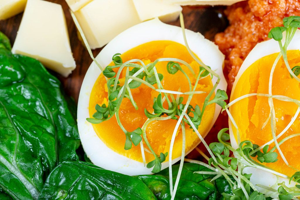 Close- up of sliced boiled eggs with vegetables for Breakfast