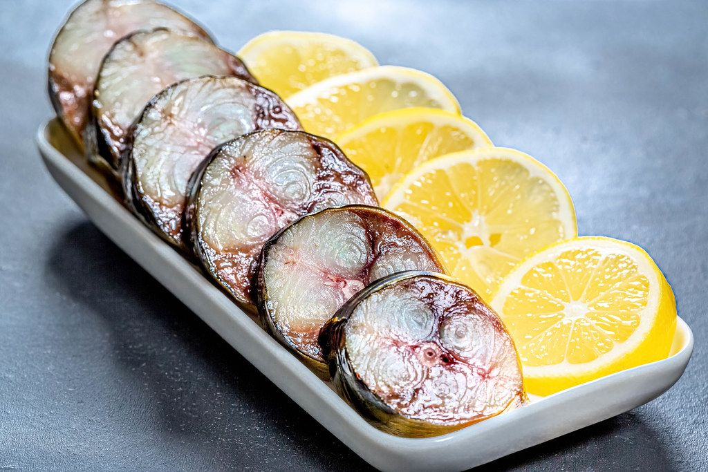 Close up of sliced pieces of smoked mackerel with lemon