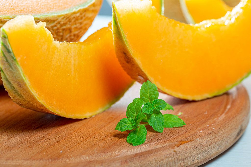 Close-up of slices of fresh melon on the kitchen Board