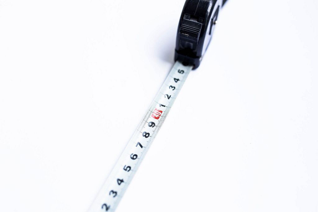 Close up of tape measure numbers on white background
