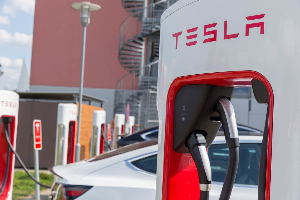 Close-up of Tesla Supercharger station and charging electric cars in Wilnsdorf, Germany