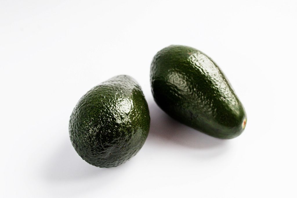 Close up of two avocados