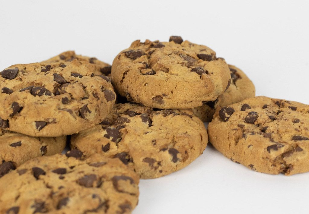 Close-up of typical American chocolate chip cookies on white background