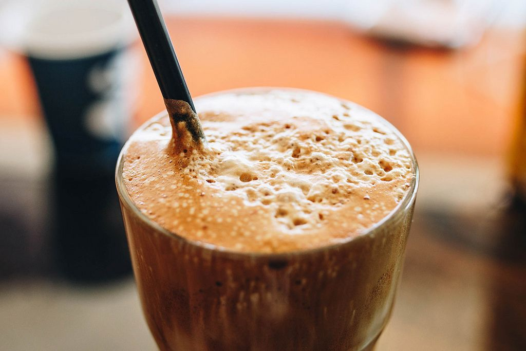 Close up of white frappe in a glass. Summer drink