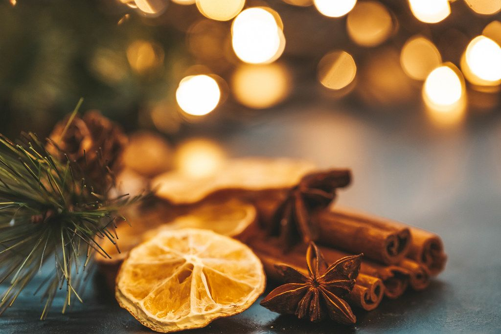 Close up of winter spices on Christmas background with Golden bokeh