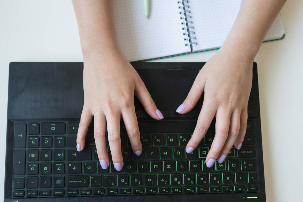 Close Up of Woman's Hands Working on the Laptop