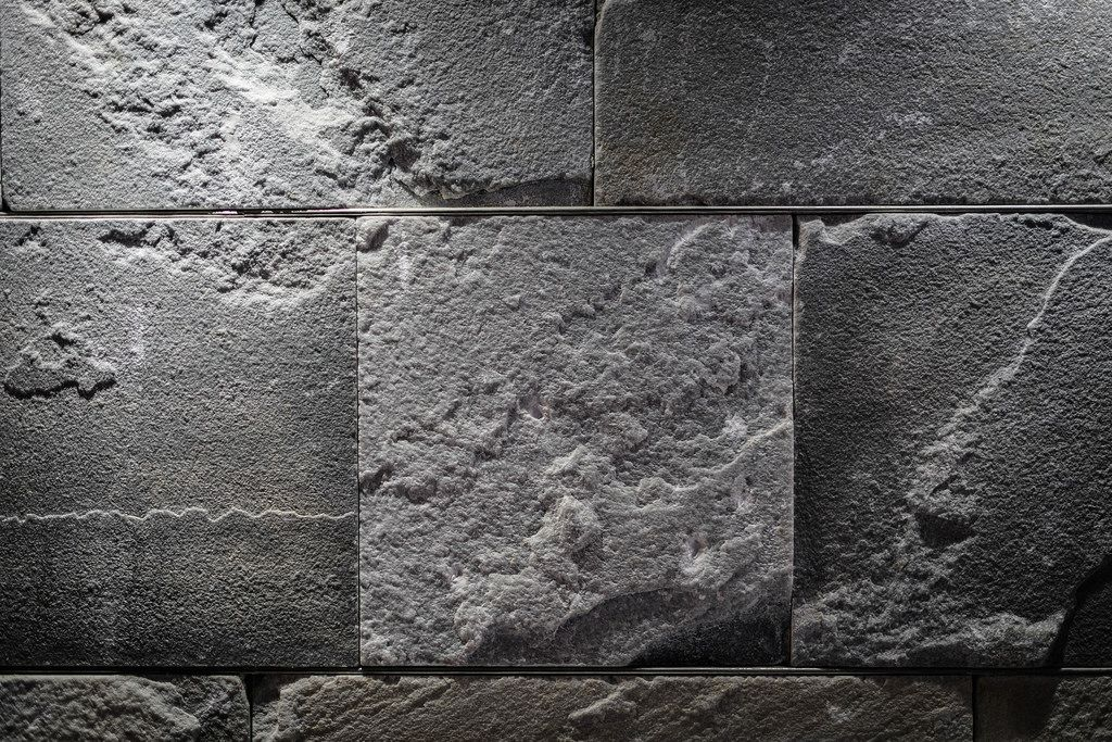 Close Up on a Illuminated  Gray Stone Wall