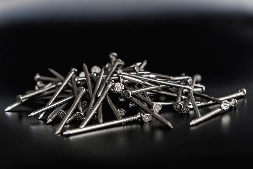 Close up on a Pile of Nails on the Black Background