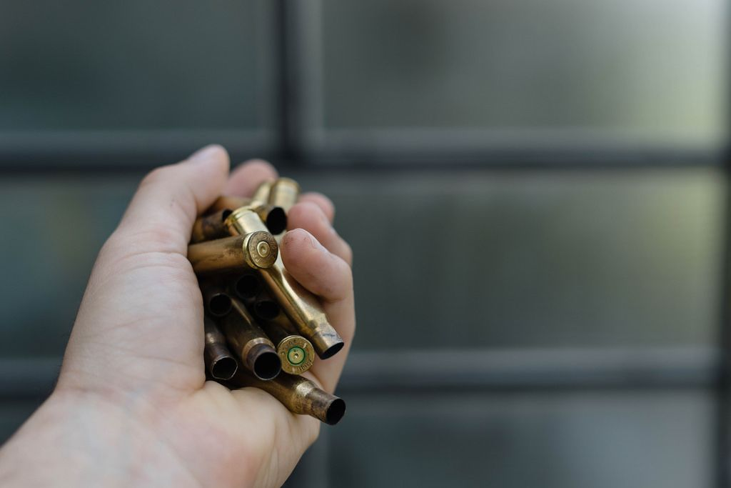 Close Up On Hand Holding Bullet Shells