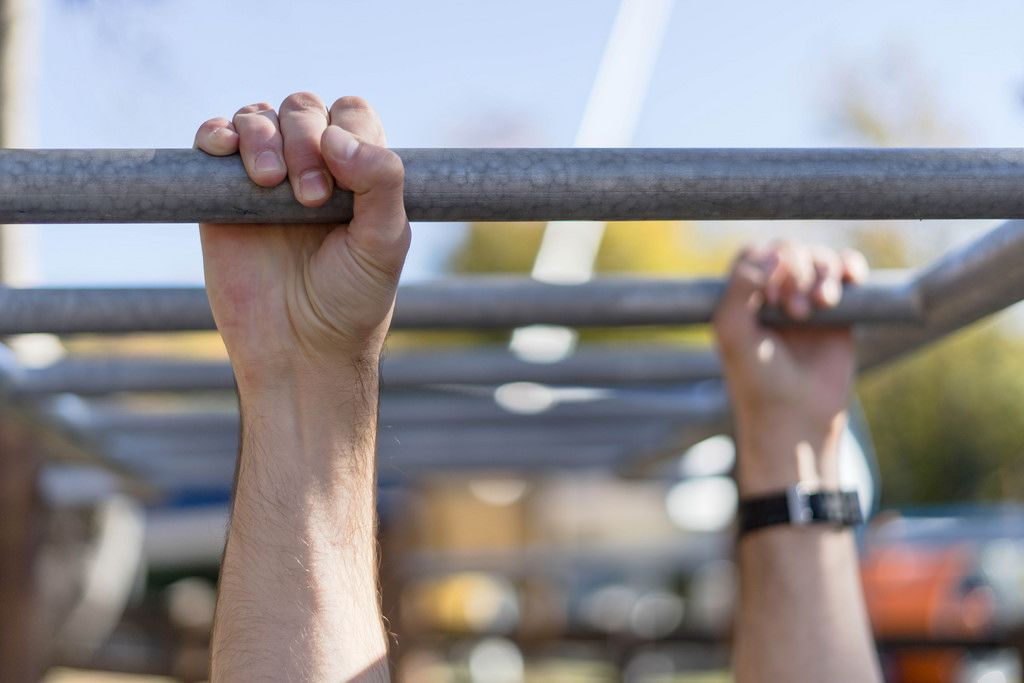 Close Up on the Hands While Workout on the Horizontal Ladder