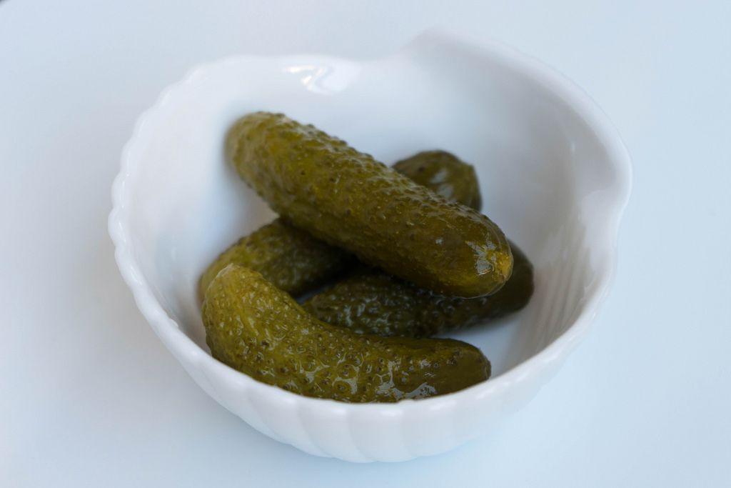 Close Up on the Pickles in the White Bowl