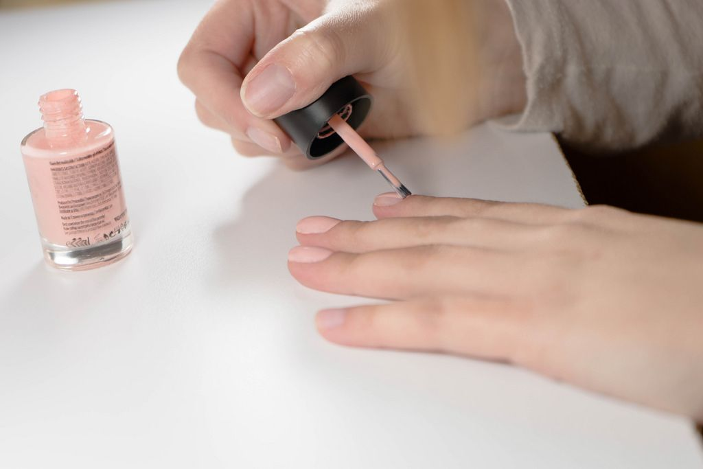 Close Up on Woman's Hands While Painting Nails