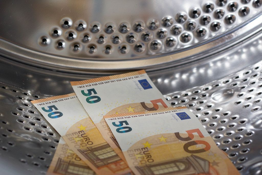 Close Up Photo of 50 Euro Banknotes in a Washing Machine Drum to depict Money Laundering