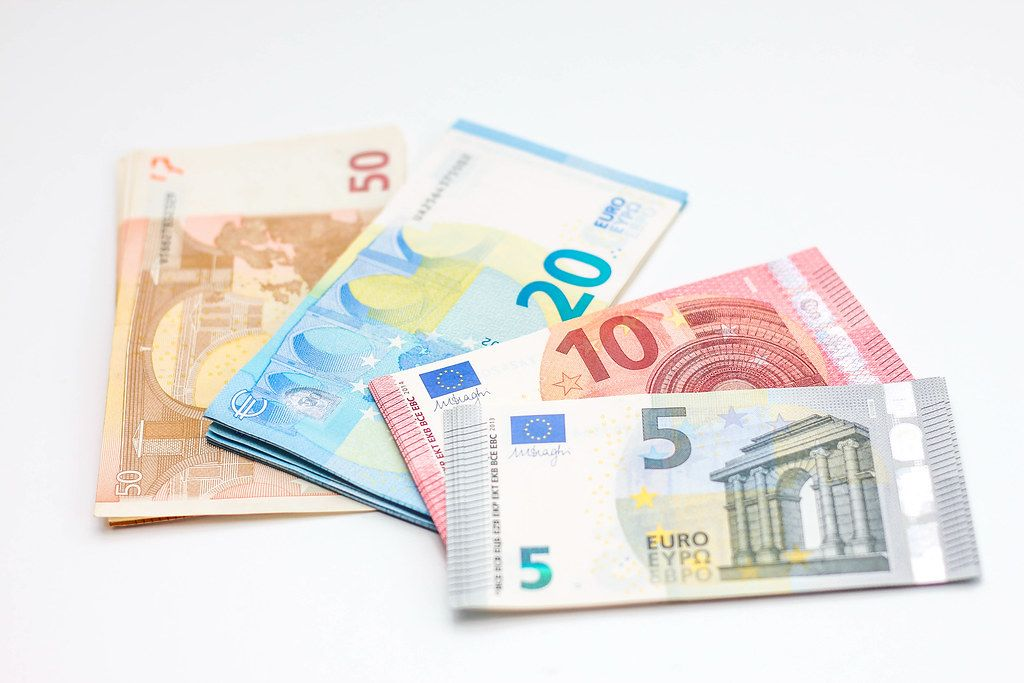 Close Up Photo of different Euro Banknotes on White Background