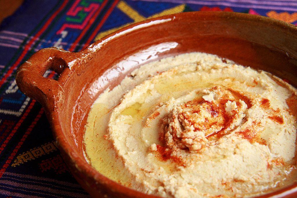 Close Up Photo of Homemade Hummus in a Ceramic Bowl