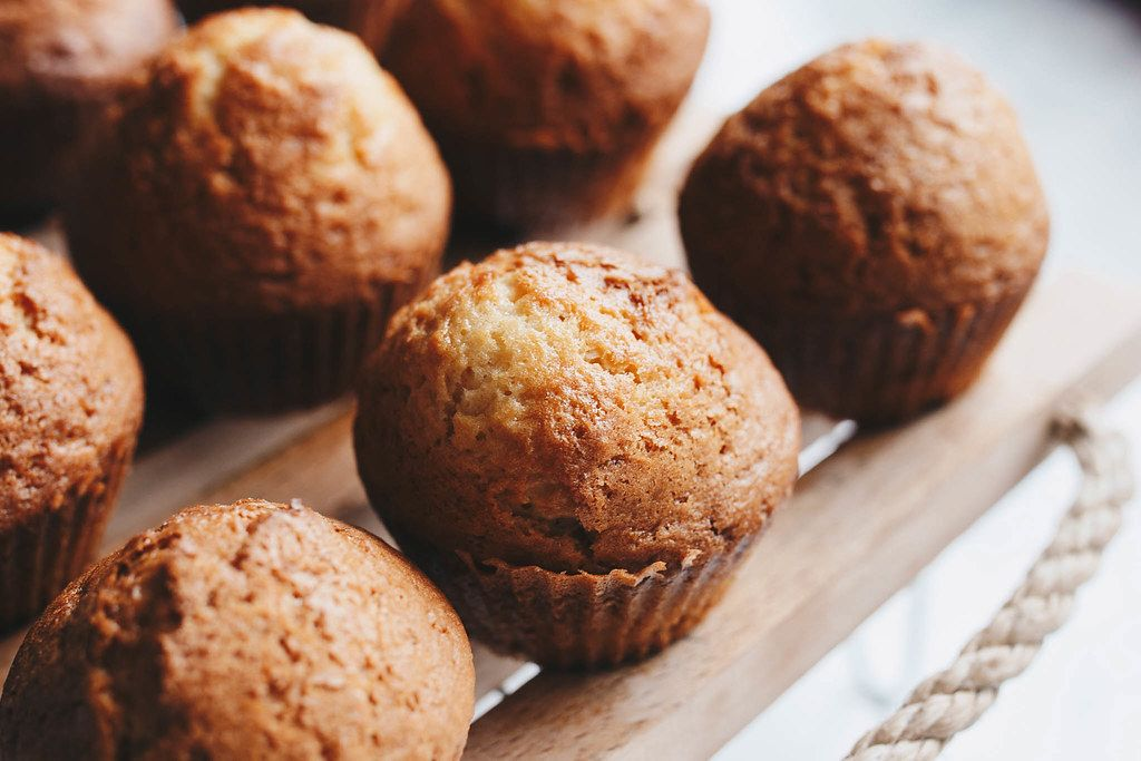 Close Up Photo of homemade Muffins on a wooden Tray