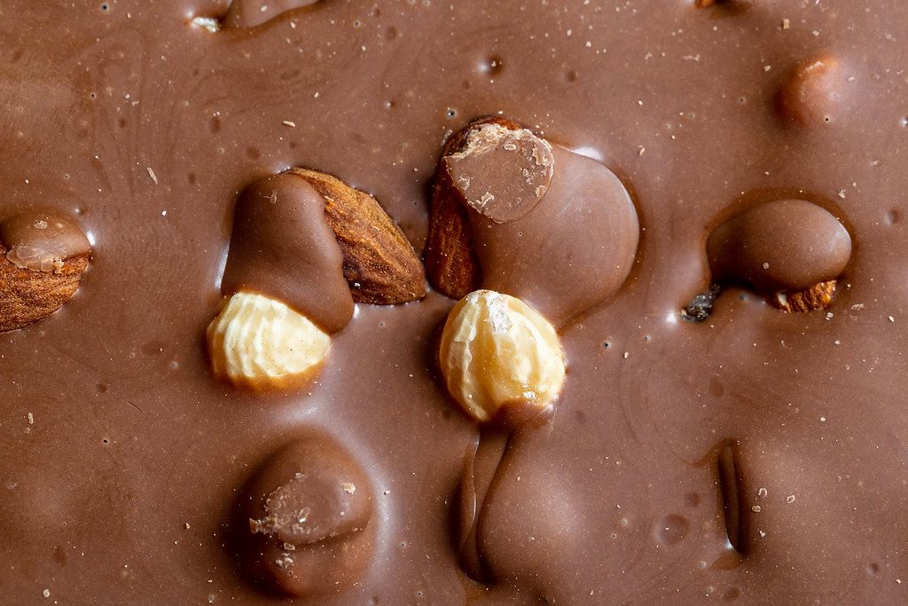Close Up Photo of Milk Chocolate with Hazelnuts and Almonds
