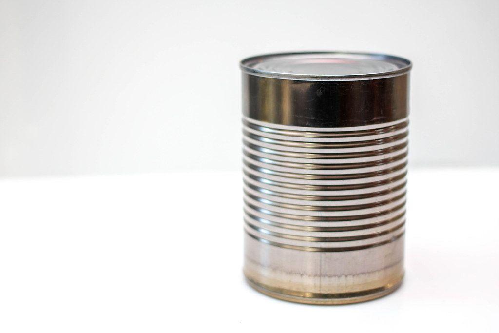 Close Up Photo of plain tin on white Background