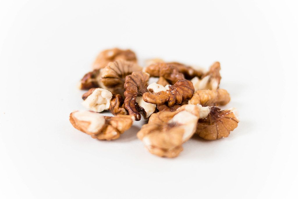 Close Up Photo of Walnuts on White Background