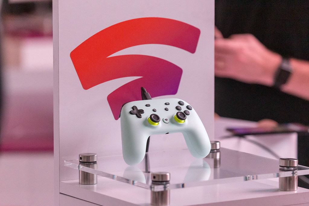 Close Up Photo of White Google Stadia Controller on display at the Gamescom Gaming Fair in Cologne, Germany