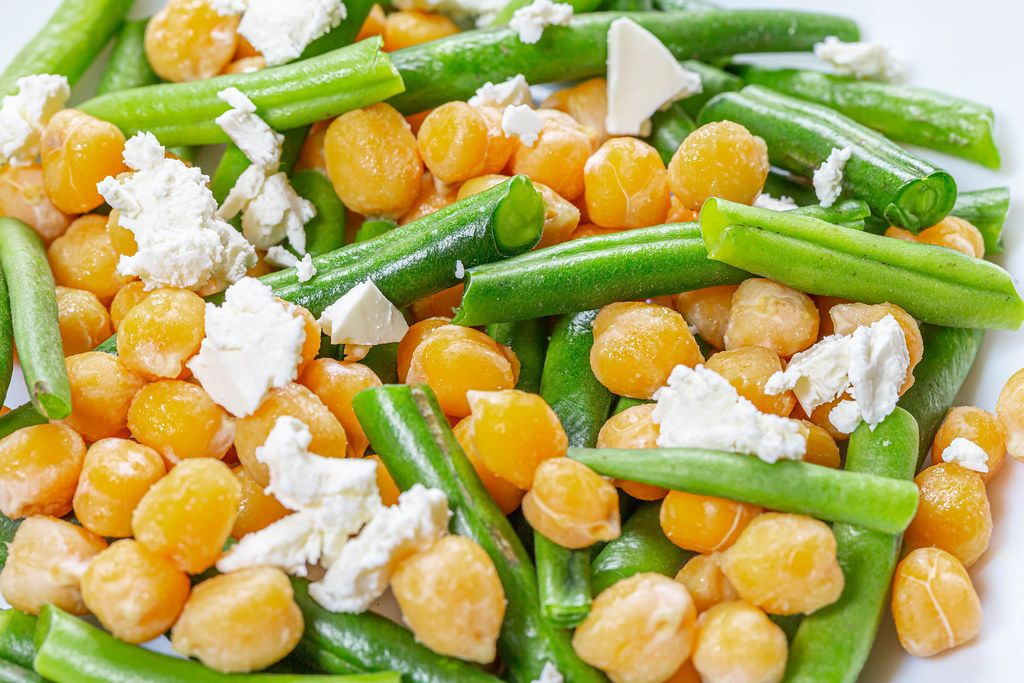 Close-up salad with chickpeas, asparagus and feta cheese (Flip 2019)