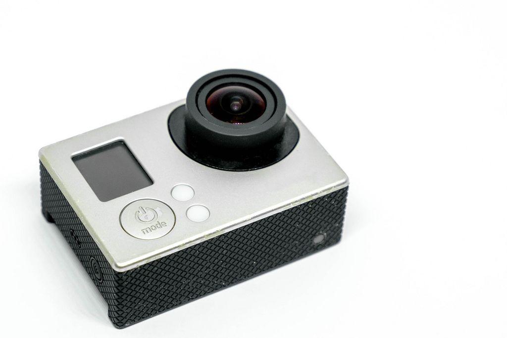Close up shot of action camera on white background