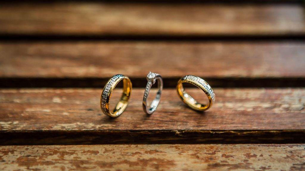 Close up shot of wedding rings on a wooden table (Flip 2019) (Flip 2019) Flip 2019