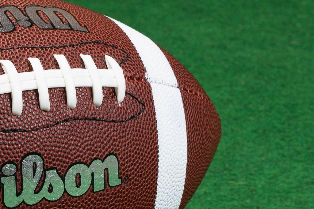 Closeup of American Football  ball on grass
