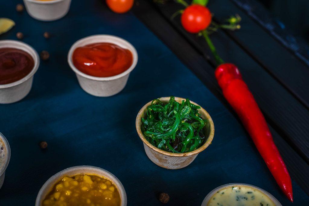Closeup of appetizer sauces. spinach sauce