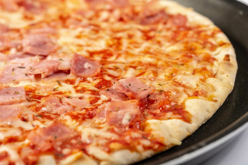 Closeup of Baked Pizza with Ham (Flip 2019)