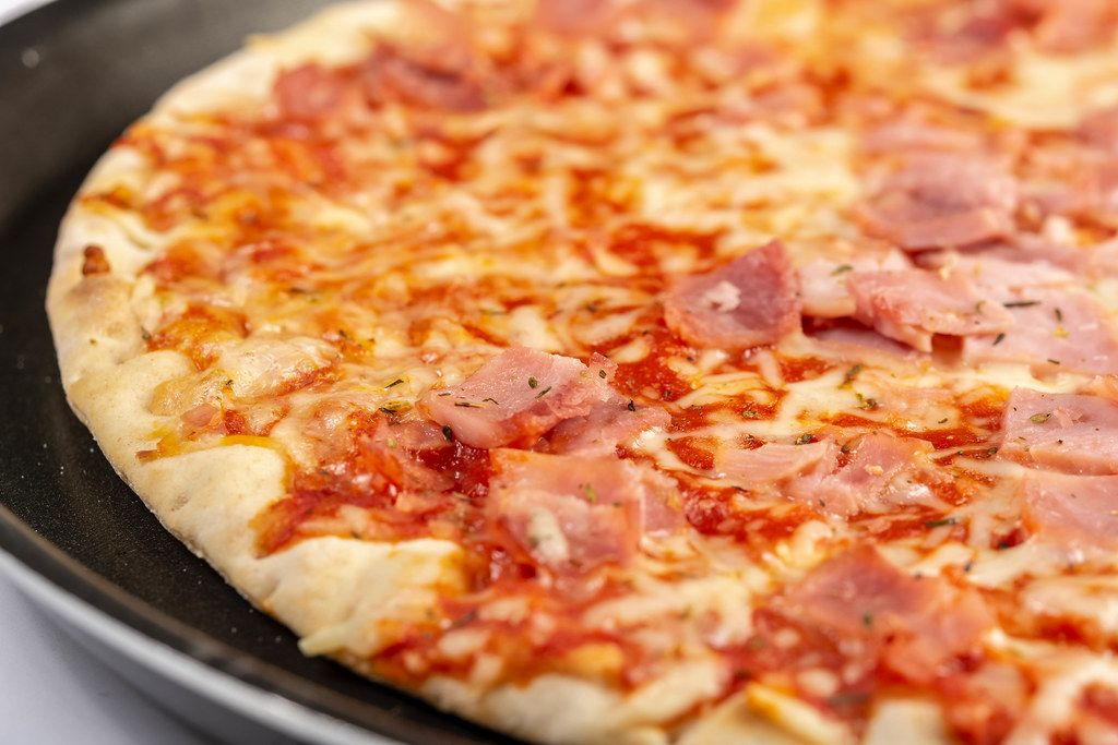 Closeup of Baked Pizza with Ham