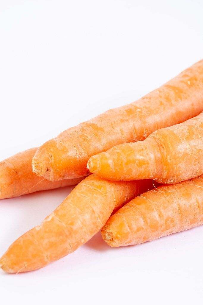 Closeup of Fresh Raw Carrots on the white background