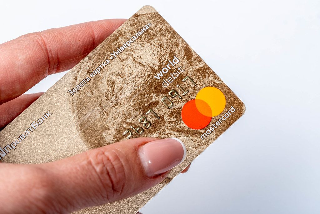 Closeup of golden plastic card in women hand
