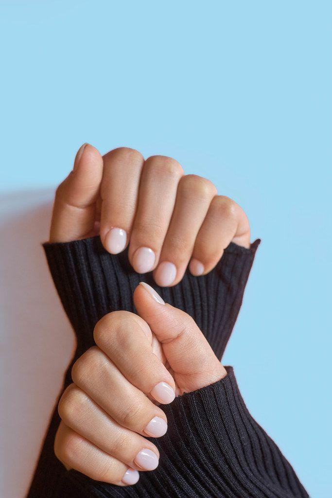Closeup photo of a beautiful female hands with elegant manicure (Flip 2020)