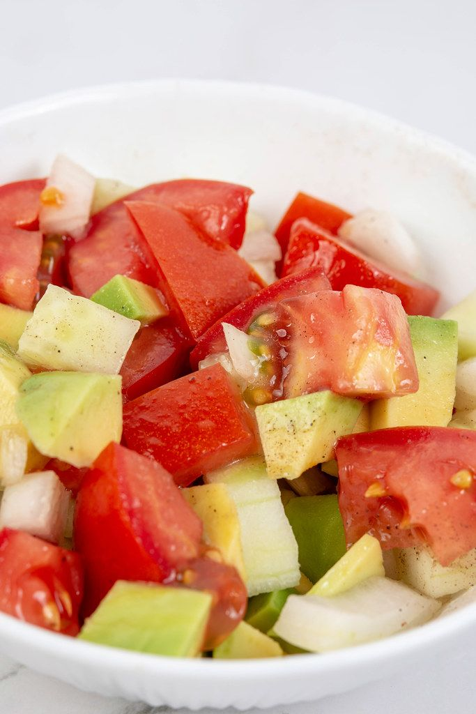 Closeup view of Avocado Tomato Onion and Cucumber Salad