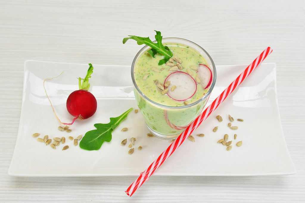 Cocktail with radish and rocket salad with sunflower seeds
